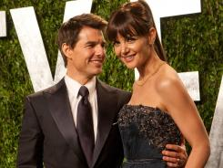 Final red carpet walk: Tom Cruise and Katie Holmes had their final official outing on Oscar night at the 'Vanity Fair' party in February.
