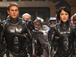 Charlie Hunnam and Rinko Kikuchi, pilot robot warriors against gigantic monsters in director Guillermo Del Toro's epic 'Pacific Rim,' in theaters July 2013.