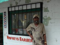 Vernon Winfrey, who stands outside of his barbershop, is in the middle of a nasty divorce with wife Barbara.
