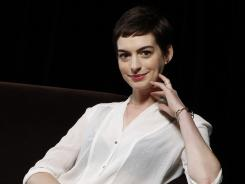 "Oscar nominee Anne Hathaway takes on an action role as Catwoman in ""The Dark Knight Rises."""