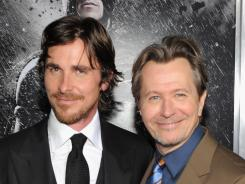 He's Batman: Christian Bale, left, plays the Caped Crusader, and Gary Oldman is Commissioner Gordon.