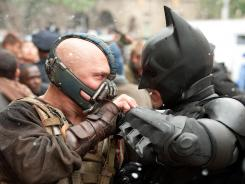 Bane (Tom Hardy) seeks to destroy Batman (Christian Bale) and Gotham in 'The Dark Knight Rises,' the conclusion to director Christopher Nolan's Batman trilogy.