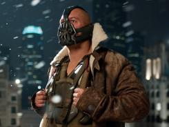 Tom Hardy stars as Bane in 'The Dark Knight Rises.' Questions are being raised as to whether there is a connection between the film and the shooting.