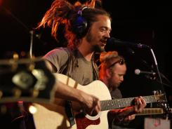 Soja front man Jacob Hemphil performs with the band during a taping of USA TODAY online video feature 'StudioA.'