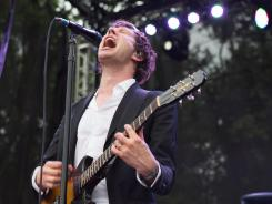 OK Go, clad in black-and-white suits and led by lead singer Damian Kulash, rocked the crowd Friday night at the Firefly Music Festival in Dover, Del.
