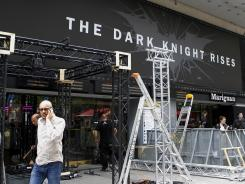 Workers dismantle an installation setup for the premiere of 'The Dark Knight Rises,' scheduled to be held Friday night in Paris on Friday.