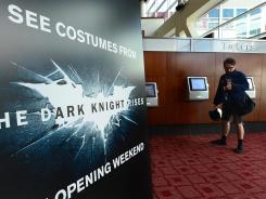 A man in Hollywood, Calif., purchases a ticket Friday for the latest Batman movie.