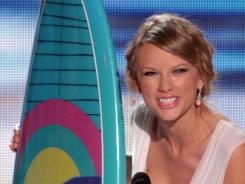 Taylor Swift picked up her 20th surfboard at Sunday's Teen Choice Awards, the most ever by a female artist.