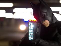 Christian Bale stars as Batman in 'The Dark Knight Rises,' which had a record-setting weekend despite a mass shooting at a Friday screening of the film that shocked the world.