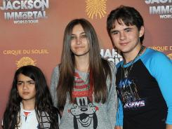 "Prince Michael ""Blanket"" Jackson, left, Paris Jackson and Prince Jackson arrive at the Michael Jackson: The Immortal World Tour in Los Angeles."