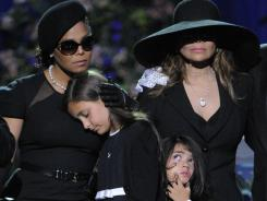Janet Jackson, left, Paris Katherine Jackson, Prince Michael Jackson II and LaToya Jackson attend the July 2009 memorial service for Michael Jackson in Los Angeles. Jackson's children have been placed in the custody of Tito Jackson's son, TJ.