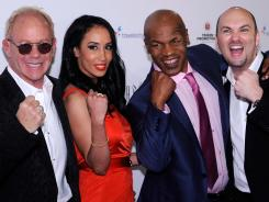 'The Undisputed Truth' team, from left, co-writers Randy Johnson and Kiki Tyson, star Mike Tyson and creator and producer Adam Steck, attends the show's opening in April in Las Vegas.