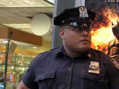 A policeman stands outside a movie theater in New York during a showing of 'The Dark Knight Rises.'