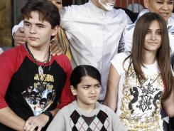 Michael Jackson's children are Prince Jackson, left, Blanket Jackson and Paris Jackson.