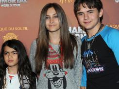 "Prince Michael ""Blanket"" Jackson, left, Paris Jackson and Prince Jackson arrive at the Michael Jackson The Immortal World Tour in Los Angeles."