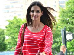 Popular girl: Katie Holmes has remained in the news for more than a month since filing for divorce from Tom Cruise in late June.