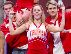 Campbell (Taylor Louderman, center) is the heir apparent to head cheerleader at Truman High School.