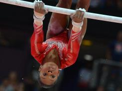 Team USA's Gabby Douglas, along with teammate Aly Raisman, competes in the women's all-around gymnastics finals, which air tonight on NBC.