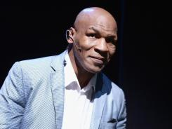 Mike Tyson takes part in a curtain call following his one-man show.