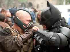There is a clear victory between Bane (Tom Hardy), left, and Batman (Christian Bale) at the end of 'The Dark Knight Rises.' But the movie's success at the box office may be harder to judge.