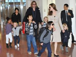 Family affair: The children of the Jolie-Pitt clan, Zahara, left, Knox, Maddox, Shiloh, Pax and Vivienne, might influence the tone of their parents' wedding.