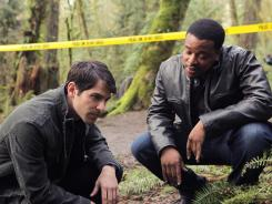 Detective Nick Burkhardt (David Giuntoli), left, and partner Hank Green (Russell Hornsby) investigate paranomal crimes in 'Grimm.'