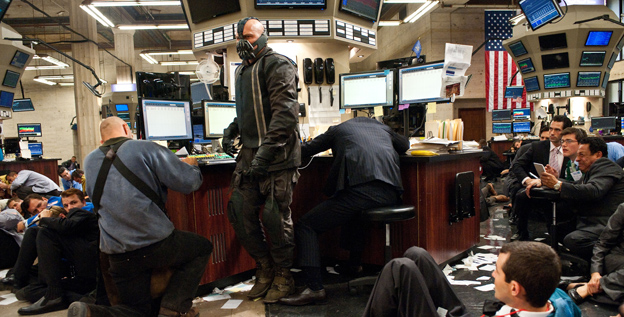 Batman villain Bane (Tom Hardy) brings the fight directly to Wall Street in 'The Dark Knight Rises.'