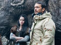 The affair between 'Snow White and the Huntsman' star Kristen Stewart, center, with co-star Chris Hemsworth, left, and the film's director, Rupert Sanders, right, won't stop the production of a sequel, Universal Pictures says.