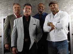 Dolph Lundgren, left, Sylvester Stallone, Terry Crews and Randy Couture reunite for more action in 'The Expendables 2.'
