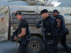 'The Expendables 2,' featuring returning performances by Sylvester Stallone, left, Jason Statham and Terry Crews is more entertainingly cartoonish than the original.