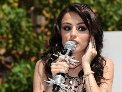 Cher Lloyd's 'Want U Back' has sold nearly 1 million downloads in the USA.