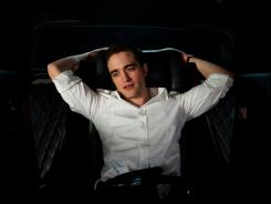 Robert Pattinson plays a financier who must navigate his limousine through mobs of protesters in 'Cosmopolis,' opening Friday.