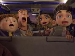Neil, left, Mitch, Courtney and Norman react to a zombie breaking into their van in 'ParaNorman.'