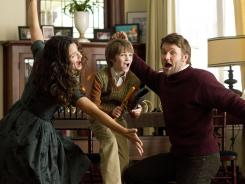 'The Odd Life of Timothy Green,' starring Jennifer Garner, left, CJ Adams and Joel Edgerton, gives a good effort but can't overcome sappy sentimentality and gaping plot holes.