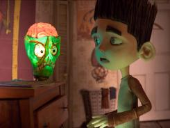 Ghoul whisperer Norman (voiced by Kodi Smit-McPhee) gets spooked by his zombie lamp in 'ParaNorman.'