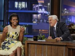 "First lady Michelle Obama, left, talks with ""The Tonight Show"" host Jay Leno during a taping in Burbank, Calif., on Monday."