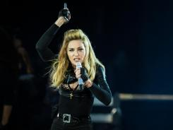 Nine activists have filed suit against Madonna for offenses during a concert in St. Petersburg Russia where she verbally supported gay rights. A law exists in Russia making it illegal in St. Petersburg to promote homosexuality to minors.