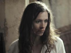 Florence Cathcart (Rebecca Hall) debunks supernatural claims and has written a book about it, 'Seeing Through Ghosts.'