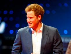 Prince of parties: Prince Harry was snapped in the buff after a wild weekend in which U.S. city?