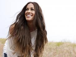 Alanis Morissette shows both a newfound contentment and her usual bombast in the new album 'Havoc and Bright Lights.'
