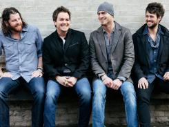 James Young, left, Mike Eli, Jon Jones and Chris Thompson are the Eli Young Band.