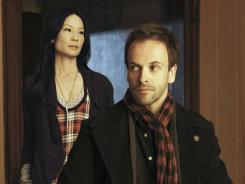 Detecting a trend: Jonny Lee Miller is Sherlock Holmes and Lucy Liu plays Dr. Joan Watson in CBS' 'Elementary,' which premieres Sept. 27.