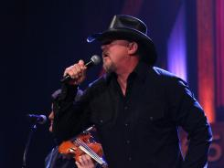 "Trace Adkins says his song 'Tough People Do' reminds Americans that ""We still have the wherewithal, still have the muscle to straighten out this incredibly twisted frame that we're driving on."""