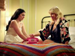 Lauren Miller, left, and Ari Graynor operate a phone sex hotline to pay the bills in New York City in the sincere but sitcom-styled comedy 'For A Good Time, Call.'