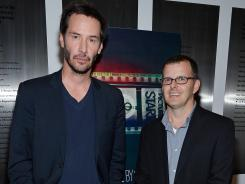 Producer Keanu Reeves, left, and director Christopher Kenneally tell the story of movies' transition from film to a digital medium.