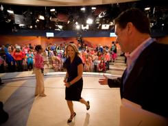 Katie Couric walks off stage after completing a taping of her new daytime talk show at the ABC studios in New York.