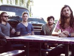 Imagine Dragons, from left, Ben McKee, Dan Reynolds, Daniel Platzman, Wayne Sermon, show off the goods to step up to bigger audiences and arenas in their new album 'Night Visions.'