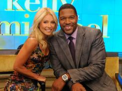 NFL player turned commentator Michael Strahan took his spot alongside Kelly Ripa on 'Live' Tuesday in New York.