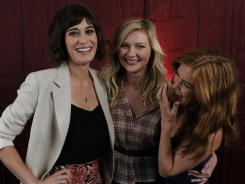 Lizzy Caplan, Kirsten Dunst and Isla Fisher play friends in their new film, and seem to get along well off-screen, too.