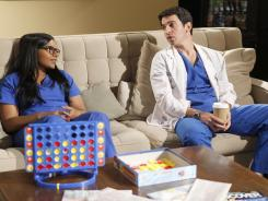 Mindy Kaling and Chris Messina watch a romantic comedy together in the new comedy 'The Mindy Project.'